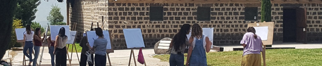 Student painting in the Tel- Hai College yard